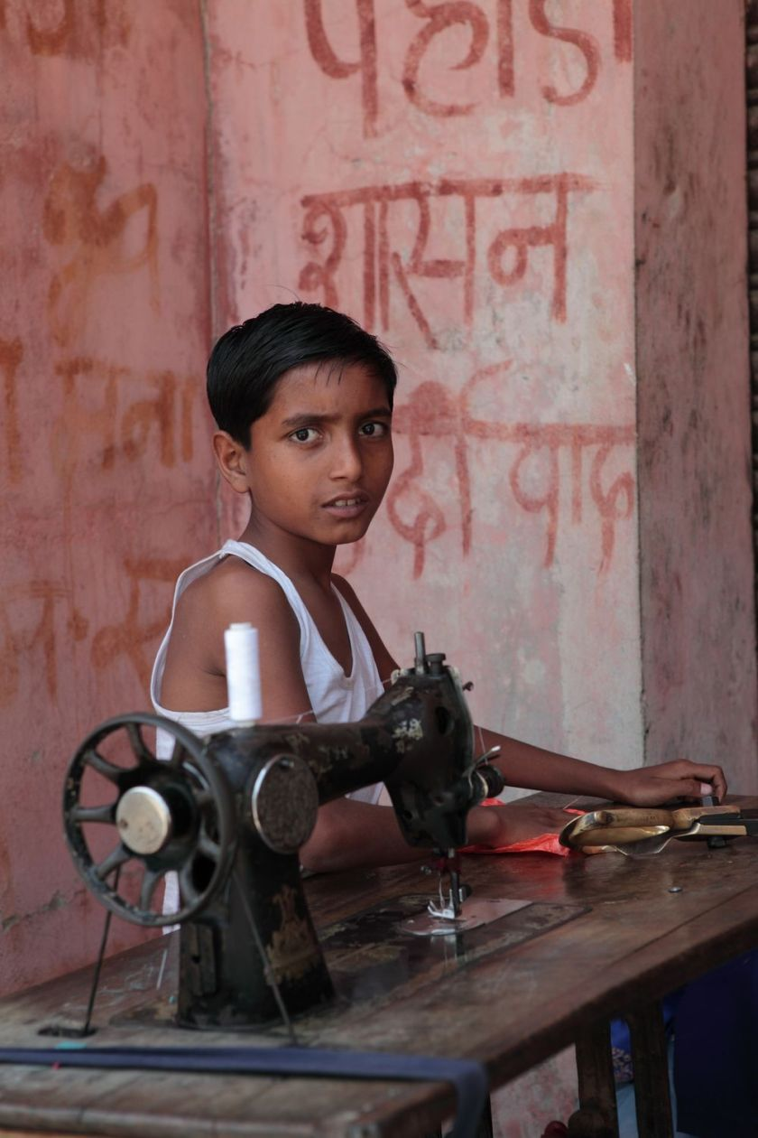 Boy with sewing machine